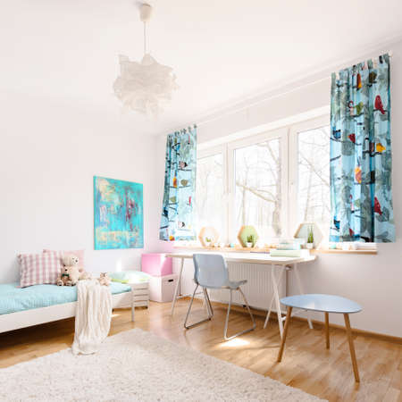 Very bright and airy room with light furniture, subtle decorations and large fluffy carpet in the foreground Reklamní fotografie