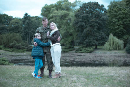 Soldier spending time with his family in the park Stock Photo