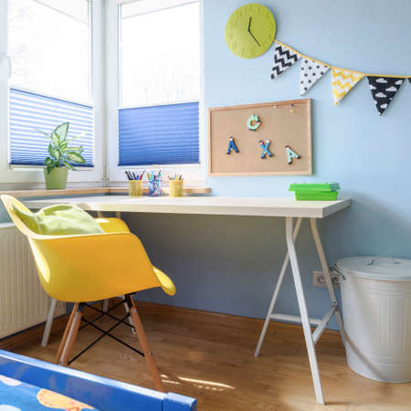 Shot of a desk in a colorful childrens room