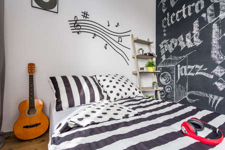 Shot of a bedroom decorated with music-related items