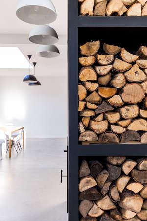 Original way to expose firewood in modern, spacious house Stock Photo
