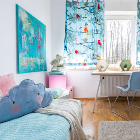 Shot of a modern cosy childrens room with soft blue pillow Stockfoto