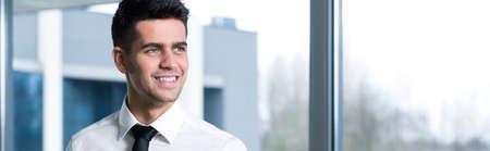 Young handsome smiling businessman in white shirt Zdjęcie Seryjne