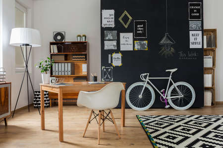 Modern apartment with hipster and scandynavian design, with blackboard wall and white vintage bicycle