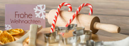 frohe: Close-up of wooden roller, lollipops and christmas wishes german