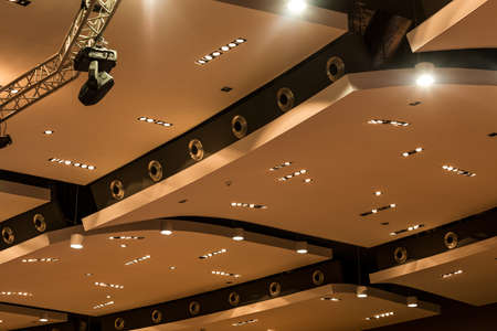 Modern dropped ceiling made up of geometrical separated parts with the lighting system Stock Photo