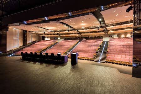 elective: Lecturers platform in large academys auditorium with many wooden seats and backlight