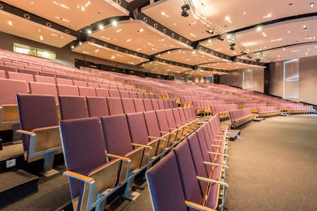 elective: Large space of lecture hall in academy, with modern ceiling backlight and wooden seats for listeners