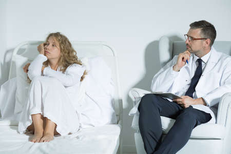 hospital patient: Mental hospital patient talking with a psychiatrist Stock Photo