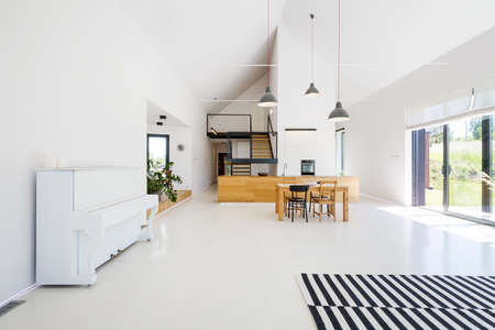 room: Spacious scandynavian style living room with white walls and stripped carpet