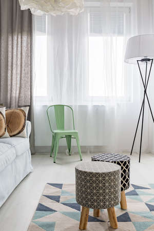 lampshade: Light room with upholstered stools, pattern carpet, floor lamp Stock Photo