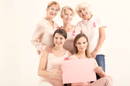 mammography: Women against cancer holding pink paper card