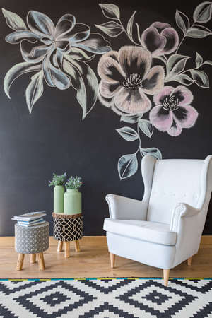 modern chair: Room with white armchair, pattern carpet and chalkboard