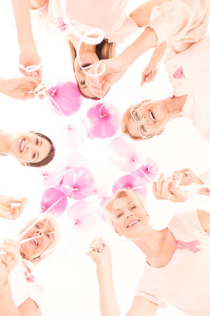 fighting cancer: Group of ladies fighting against breast cancer, bottom-up view Stock Photo
