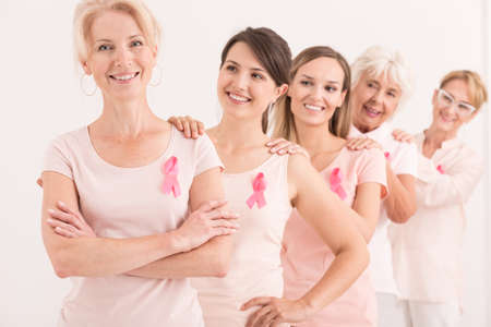 Women supporting each other in fight against cancer Imagens
