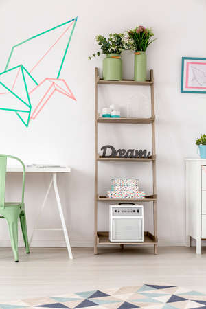 room decoration: Part of the room with creative shelves and pastel decoration