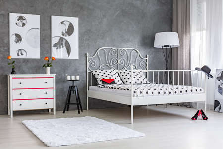 double bed: Grey room with white dresser and double bed