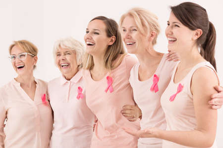 Happy breast cancer survivors supporting each other 版權商用圖片 - 66120879
