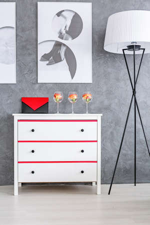 small details: Grey room with white dresser and floor lamp