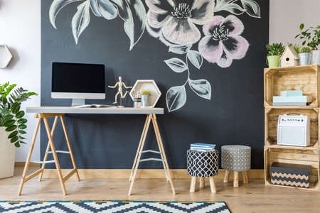 upholstered: Home workspace with diy regale and upholstered pouf