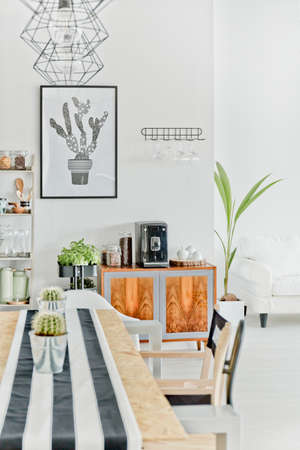 Modern dining area with wooden table, chair and pendant lamp