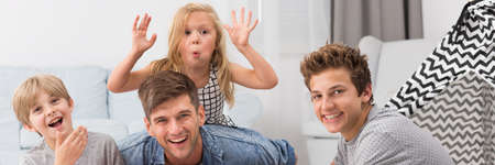 clowning: Young girl clowning with her brothers and father Stock Photo
