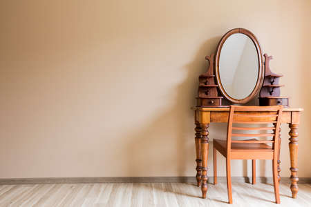 wood panelled: Wooden renovated vanity with an oval mirror in a nude interior