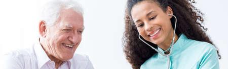man doctor: Friendly nurse is examining her elder patient