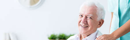sick person: Elder man is very happy because of his company