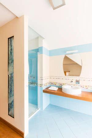 bathroom wall: Modern bathroom with blue tiles and fancy wall