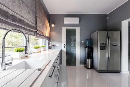 Modern Kitchen With Big Windows, Elegant Kitchen Units And Silver ...