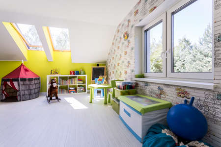 roof windows: Bright room for children with roof windows, panels and various toys Stock Photo