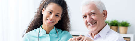 old time: Old man is spending time with his nurse  Stock Photo