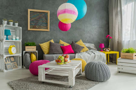 hassock: Easy room makeover- paper lamps,wool poufs and pillows