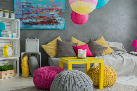 Ideas about ottoman- natural wool pouf and colorful decorations Stock Photo