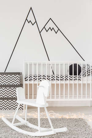 wall decoration: Baby room with white cot, rocking horse and wall sticker
