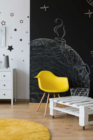 room: Childrens room with chalkboard wall and white and yellow furniture