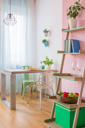 Small cozy dining room with pastel furniture