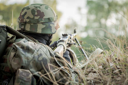 maneuver: Army soldier taking part in military maneuver outdoor