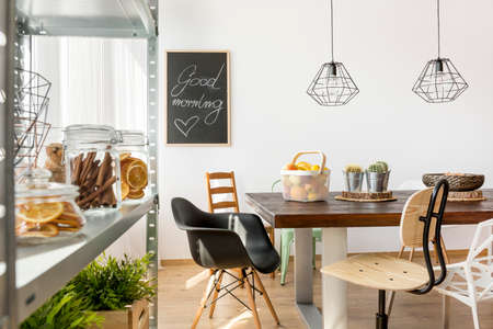industrial design: Dining area in industrial style with table, chairs and regale