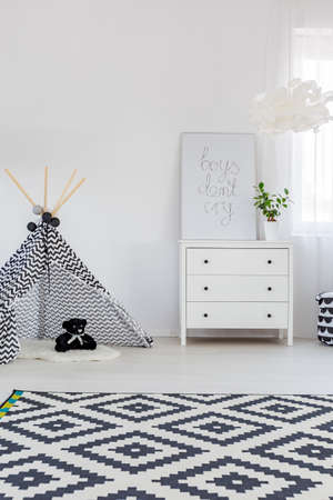 Child bedroom with dresser, carpet and play tent