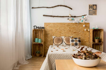 kingsize: Cozy brown and white bedroom with king-size bed and DIY accessories Stock Photo