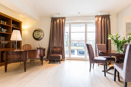 lightsome: Spacious elegant study with big window, piano and mahogany furnitures Stock Photo