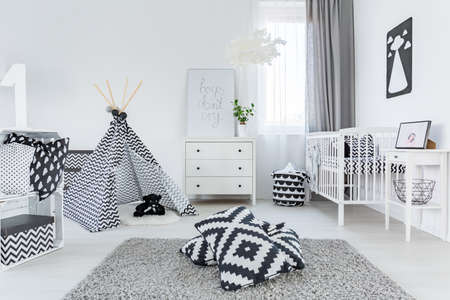 scandinavian people: Child room in scandinavian style with carpet, cot and dresser