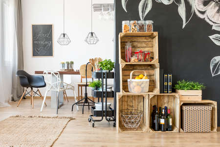 natural light: Interior with dining table and diy crate shelves Stock Photo