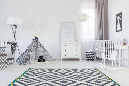 Black and white baby boy room with tent and carpet