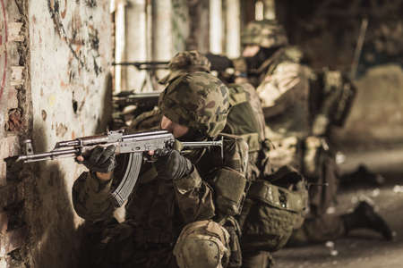 maneuver: Young army soldiers during training exercise with weapon Stock Photo