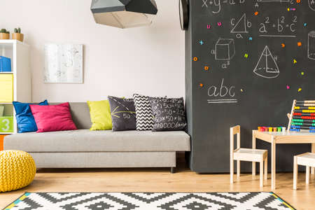 modern design: Modern room with patterned carpet and wall covered with formulas Stock Photo