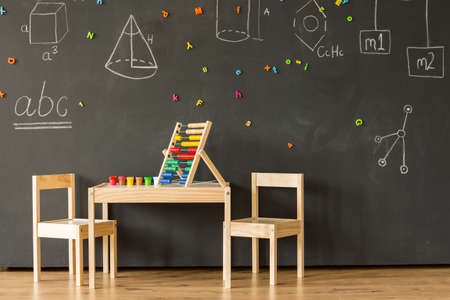 Prodigy: Modern classroom with blackboard, little wooden furniture and colourful abacus Zdjęcie Seryjne