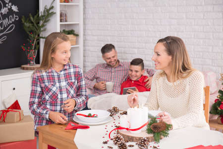 family  room: Happy family sitting in a dining room before Christmas dinner